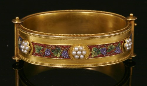 Lot 37-A cased Archaeological Revival gold micromosaic bangle