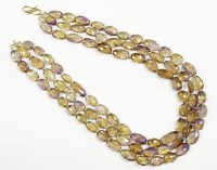 Lot 33-A three row graduated oval faceted ametrine bead necklace