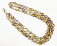 Lot 37-A three row graduated oval faceted ametrine bead necklace