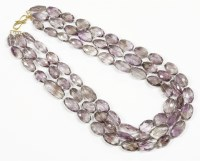 Lot 35-A three row graduated oval faceted amethyst bead necklace