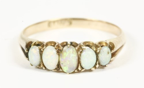 Lot 19-An Edwardian 15ct gold five stone opal cabochon ring