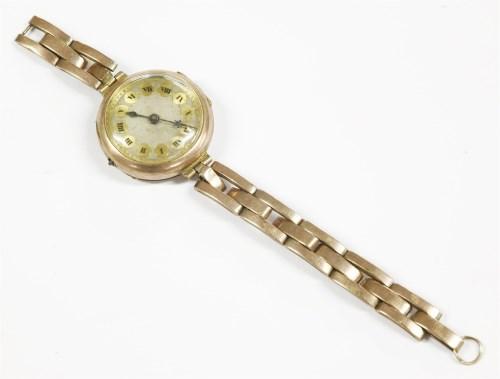 Lot 4-A ladies 9ct gold mechanical bracelet watch
