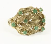 Lot 10-A 9ct gold emerald set leaf design bombé shaped ring  7.29g