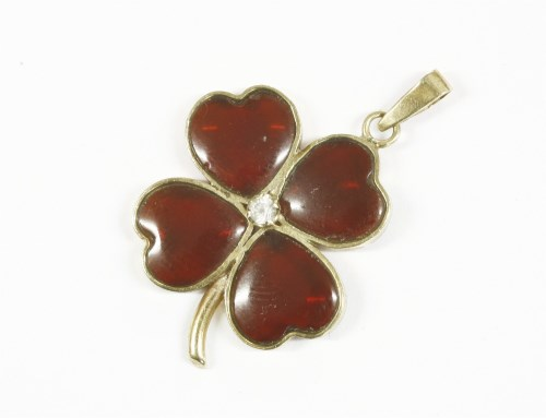 Lot 2-A 9ct gold garnet and white stone shamrock or four leafed clover pendant
