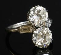 156 - An Art Deco two stone diamond fingerline ring
