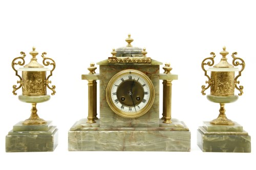 Lot 643-An Onyx clock garniture