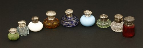 Lot 21-Nine small glass bottles with plated and silver mounts