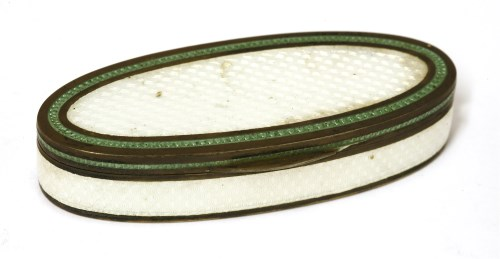 Lot 22-An oval silver gilt and enamel pill box