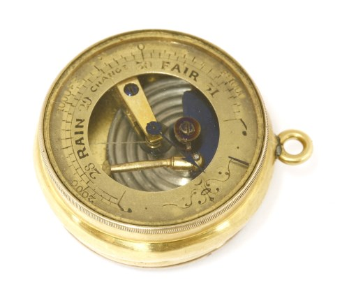 Lot 31-An 18ct gold pocket barometer and compass