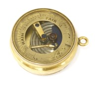 Lot 31 - An 18ct gold pocket barometer and compass