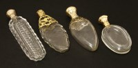 Lot 101 - Four clear glass scent bottles
