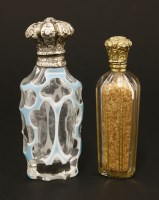Lot 83 - Two Victorian clear glass scent bottles
