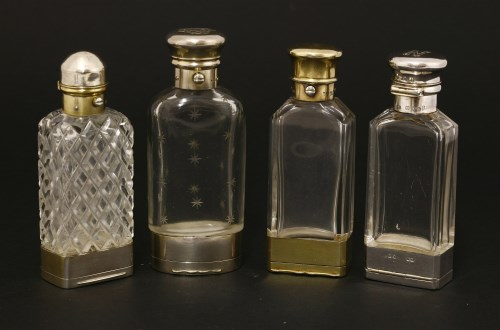 Lot 64-Four silver and glass combination scent bottles and vinaigrettes