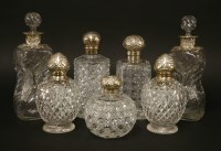 Lot 147 - A pair of moulded glass and silver-mounted decanters and stoppers