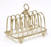 Lot 153 - A George III silver seven-bar toast rack