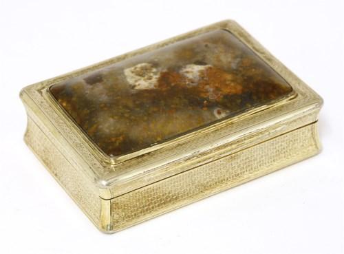 Lot 39-A George IV silver gilt and polished snuff box