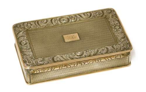 Lot 41-A George IV silver and gold-edged snuff box