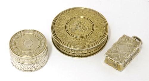 Lot 53-An unusual George III silver gilt patch snuff box
