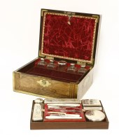 Lot 192 - A George IV gentleman's rosewood and brass bound toilet box