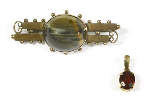 Lot 15-A late Victorian Continental gold single stone hawk's eye two row bar brooch