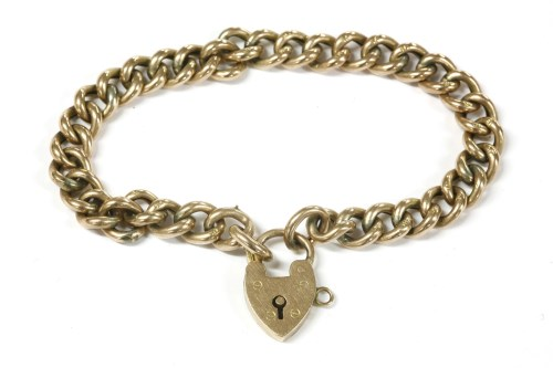 Lot 10-A 9ct gold hollow curb link bracelet with gold padlock