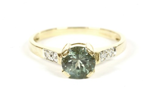 Lot 9-An 18ct gold single stone Alexandrite ring with diamond set shoulders