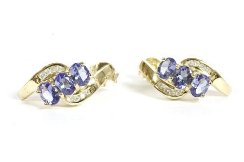 Lot 4-A pair of 9ct gold tanzanite and diamond crossover earrings