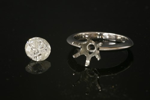 Lot 18-A platinum single stone ring mount with an unmounted brilliant cut diamond