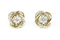 Lot 16-A pair of gold single stone diamond stud earrings