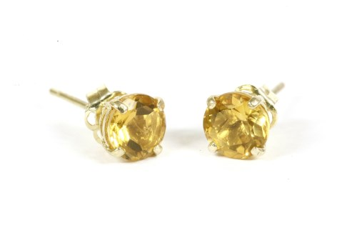 Lot 7-A pair of gold single stone citrine stud earrings