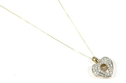 Lot 22-A gold pave set diamond heart shaped pendant