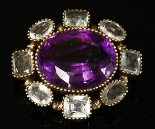 Lot 25-A Victorian silver gilt amethyst and aquamarine brooch