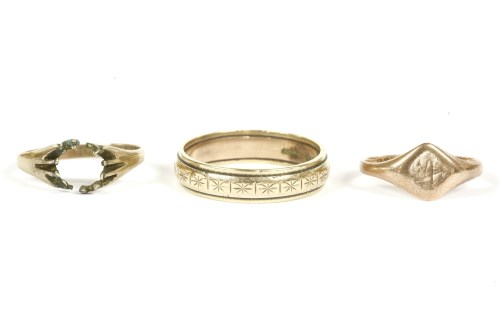 Lot 11-A 9ct gold band ring with diamond cut engraved decoration