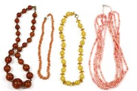 Lot 33-A single row graduated toffee coloured Bakelite bead necklace with bronzed coloured bead spacers