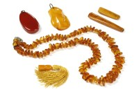 Lot 37-A single row freeform amber bead necklace