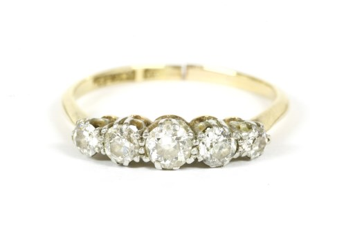 Lot 21-A gold five stone graduated diamond ring