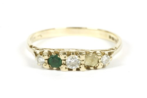 Lot 8-A 9ct gold five stone graduated diamond and emerald ring boat shaped ring