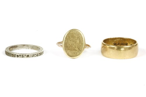 Lot 23-A single cufflink converted to a ring with hand engraved crest