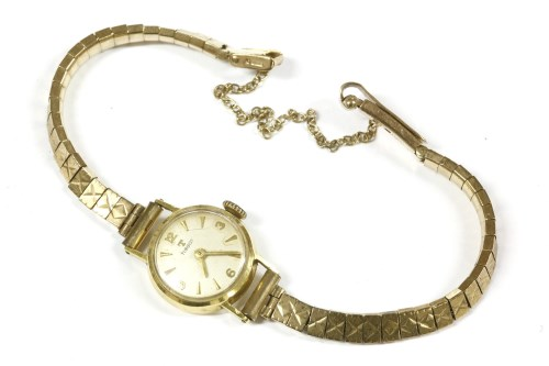 Lot 5-A ladies 18ct gold Tissot mechanical strap watch