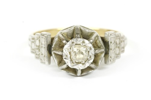 Lot 6-A single stone illusion set diamond ring
