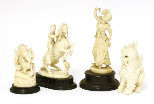 Lot 1000-A collection of four ivory carvings