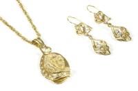 Lot 29-A gold lion head pendant set with cubic zirconias