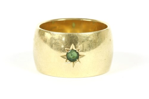 Lot 7-An 18ct gold single stone star set emerald ring