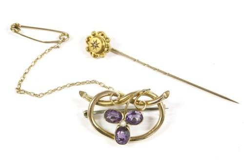 Lot 14-A gold split pearl and amethyst shamrock brooch