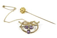 Lot 14-A gold split pearl and amethyst shamrock brooch