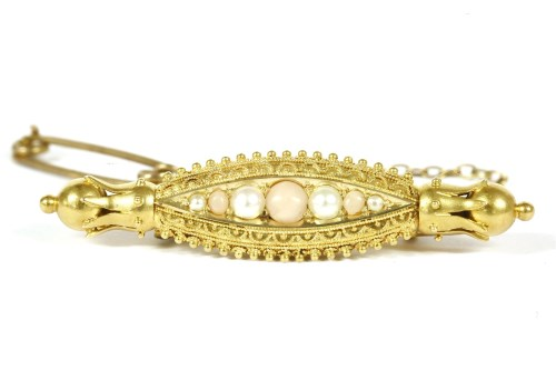 Lot 26-A Victorian Etruscan style gold coral and split pearl brooch