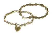 Lot 24-A 9ct gold polished and twisted wire curb link bracelet with padlock
