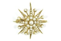 Lot 20-A late Victorian gold split pearl star brooch/pendant
