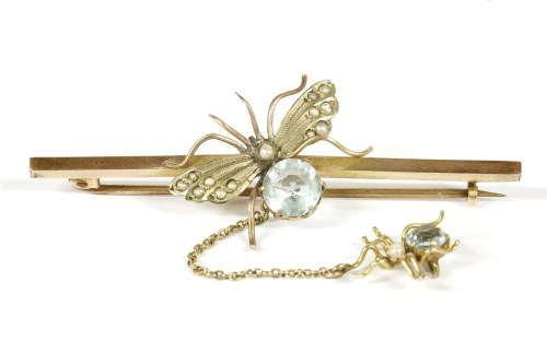 Lot 22-A gold blue paste stone moth and spider bar brooch