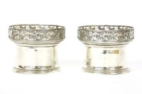 Lot 91 - A pair of silver wine related cylindrical vessels